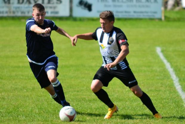 County Times: Action from the Bow Street Ardal North East League clash with Rhos Aelwyd.  Photo by Beverley Hemmings.
