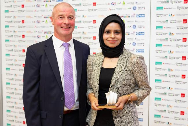 Rafia Jamil, from Knighton, receives her Womenspire Rising Star award from category sponsor, Sean Sullivan from Western Power. Picture: Mei Lewis