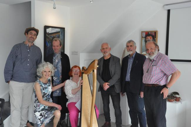 At the Mid Wales Arts Theatre exhibition launch are: Jesse Wade  ( Cathy Knapp curator) Karl Sylvestor,  Gay Roberts, who provided harp music during the afternoon, Andrew Baldwin (Aberystwyth University) John Smout and Robert Macdonald.