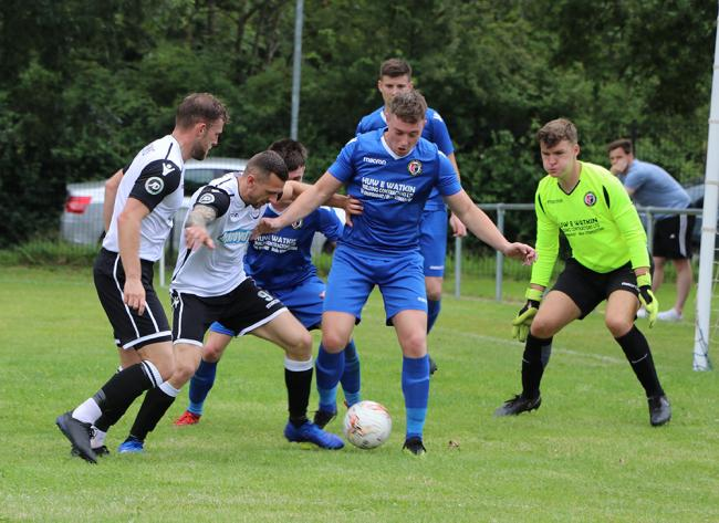 Action from Bala Town's 4-2 win at Llanrhaeadr YM. Picture: Naomi Jones