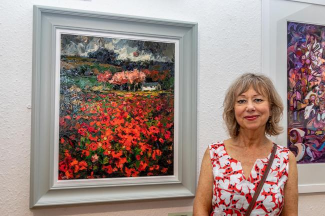 Wendy Murphy of Llwyngwiril with her oil on board work 'Cofio (Remember)'. Picture: Robert Price