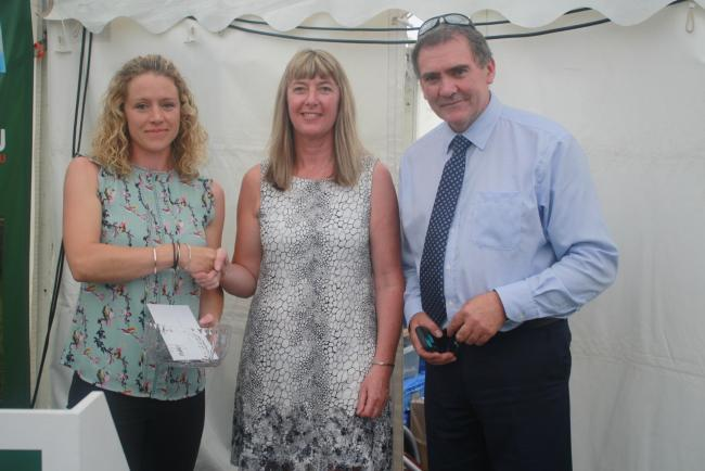 Nicola Drew was presented with a Welsh crystal engraved bowl and £500 prize money as she was named NFU Cymru/NFU Mutual Wales Woman Farmer of the Year.