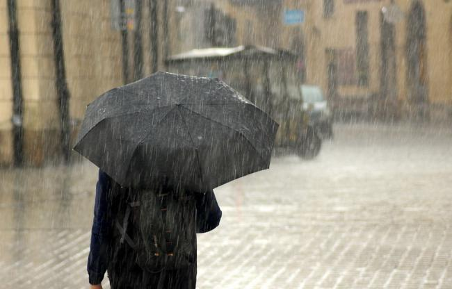 Heavy rainfall may lead to flooding in a few places and travel disruption