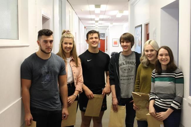 Newtown High School students receive their A-level results.