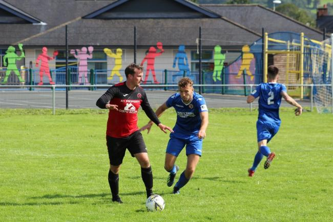 Action from Penrhyncoch's clash with Llanrhaeadr. Picture by Catrin Roberts.