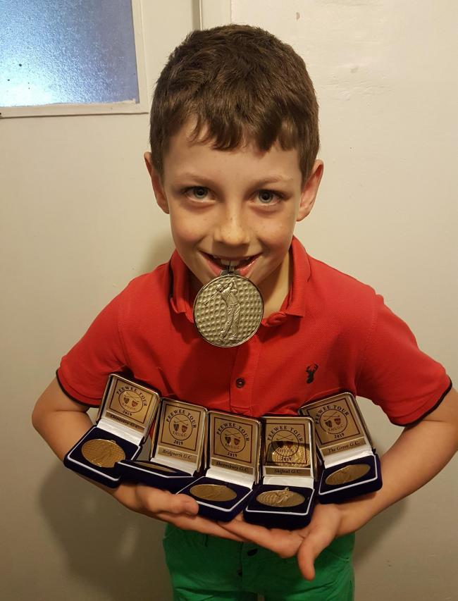 Joshua Alderton of Knighton with his medals from each of the Peewee events won this season and the tour championship medal from winning the under 8s Peewee Tour overall.