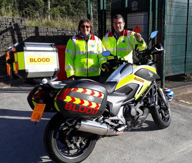 First Powys duty rider Lorraine Thomas handing over to Leigh Wallace. Photo: Blood Bikes Wales