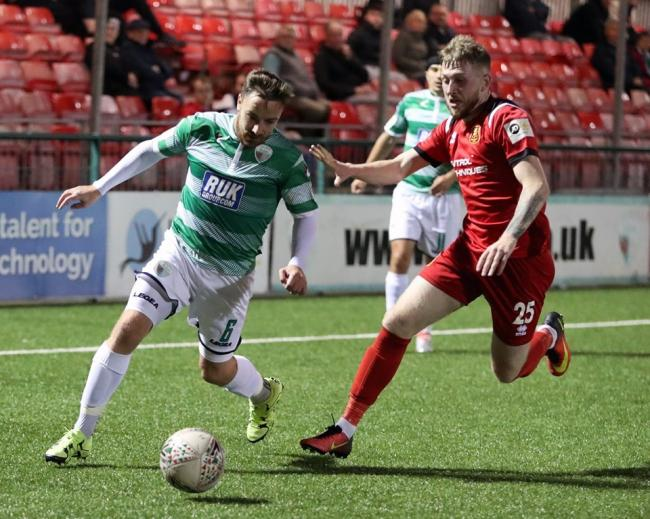 TNS' Ryan Brobbel is tracked by Newtown's Jack Kelly. Picture by Brian Jones.