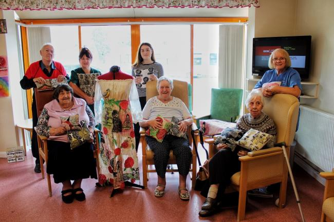 NPTC Art and Design student Katie Stallard with Llanidloes Hospital patients in the Penrallt Unit. Photo: Katie Stallard