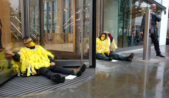 Extinction Rebellion activists, dressed as canaries, protesting in the City of London.