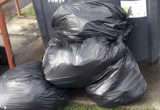 Rubbish in black bin bags.