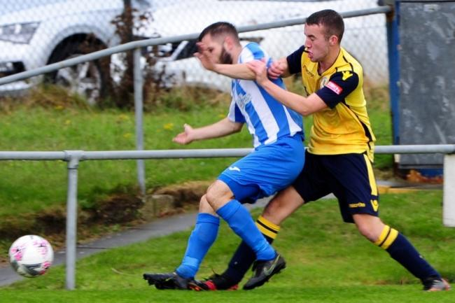 Action from Montgomery Town's clash at Holyhead Hotspur. Picture by Kevin Hughes.