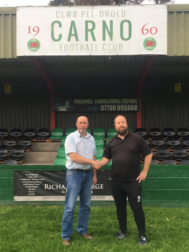 Carno Football Club representative Phil Richards welcomes Gwyfor Edwards to the club.