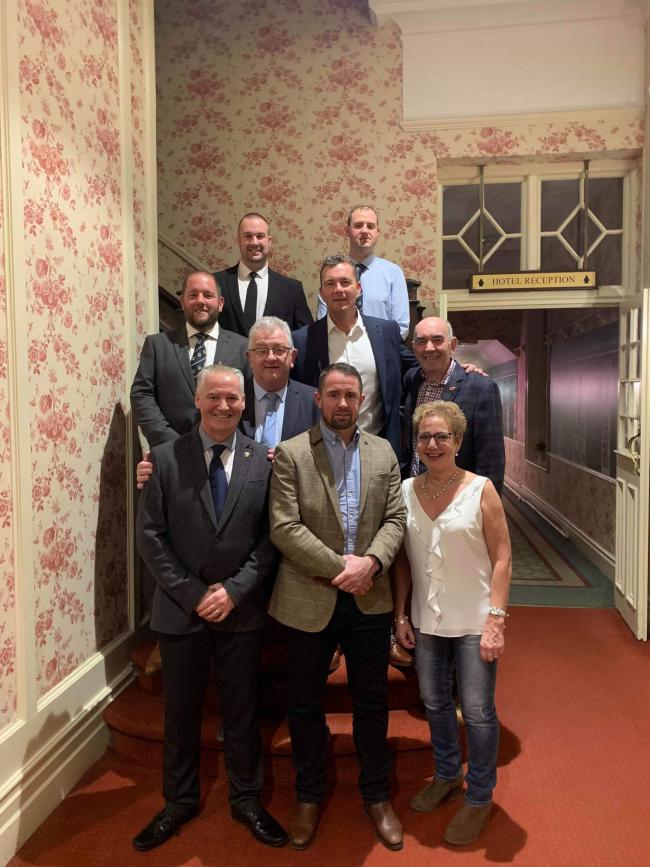 Pictured (back from left) Sean Cosgrave and Jonathan Duggan (third row) Geraint Edwards, Sean Holley (second row) Neil Holder of Adeys Taxi's, Reg Cawthorne, chairman of the Bracken Trust), Andrew Mills, Shane Williams, Ann Williams, manager of the