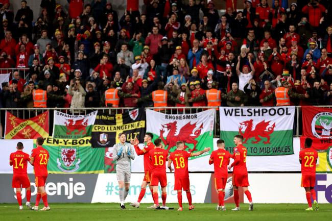 Wales players applaud the fans after the final whistle during the UEFA Euro 2020 Qualifying match at the Bakcell Arena, Baku. PA Photo. Picture date: Saturday November 16, 2019. See PA story SOCCER Azerbaijan. Photo credit should read: Bradley Collyer/PA