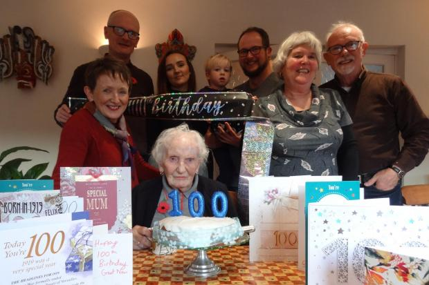 Winifred Plant, from Knighton, celebrating her 100th birthday with family members.