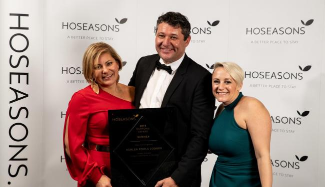 Members of the Ashlea Pools Lodges team (from left): Leanne Lewis and Leigh Burdon, receive their award from Hoseasons property and portfolio director Hayley Johnson. Picture: www.dcoolimages.com