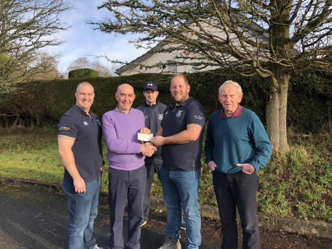 Llandrindod Wells RFC  chairman Geraint Edwards is pictured presenting a cheque for £1552 to Reg Cawthorne, chairman of the Bracken Trust.  Also pictured are Sean Cosgrave and Jonathan Duggan who helped organise the event and rugby club treasurer Jo