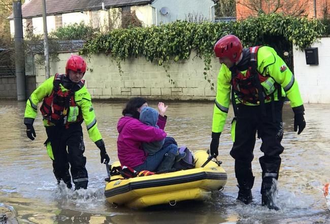 Firefighters rescue residents from Mill Green in Knighton. Picture by Welshpool Fire Station.