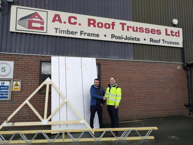 Osian Jones,Truss and Easi Joist Development Manager for the Huws Gray Group, and Tom Jones, Managing Director for AC Roof Trusses, in Welshpool.