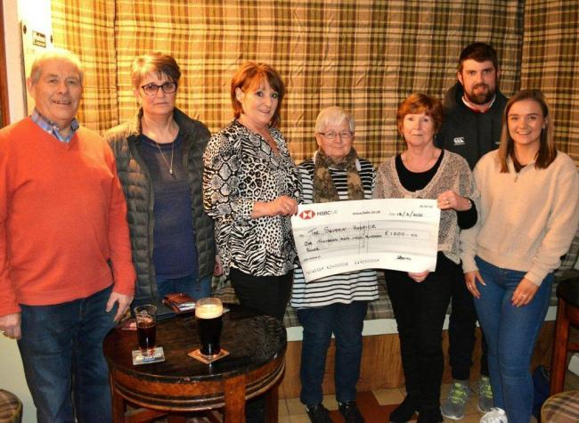 Sylvia Jones receives a cheque for £1,200 from Menna Watkins at a recent presentation evening at Cefn Coch Inn for The Severn Hospice. Picture by Elwyn Owen.