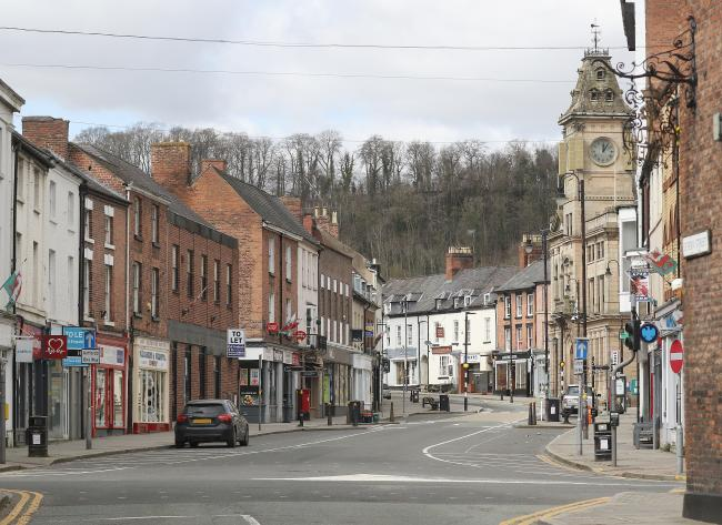 The effect of the Coronavirus in Welshpool..Pictured is an empty looking Broad Street at Midday 29th March 2020.Picture by Phil Blagg Photography..