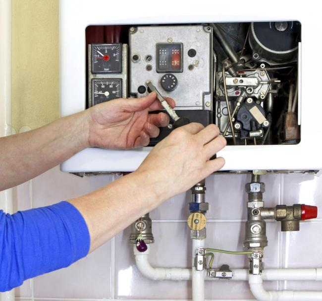 A Generic photo of an engineer repairing a boiler. Pic: PA