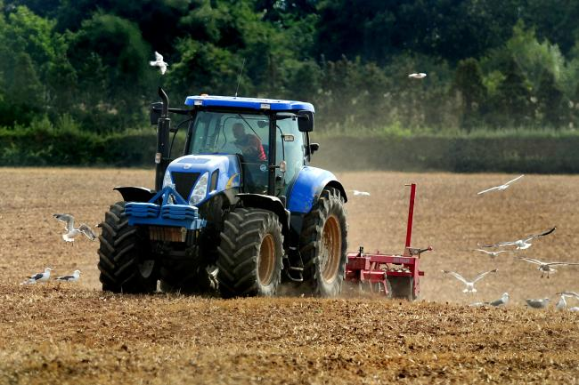 File photo dated 01/09/13 of a of tractor ploughing a field