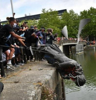 The statue of slave owner Edward Colston being thrown into Bristol Harbour