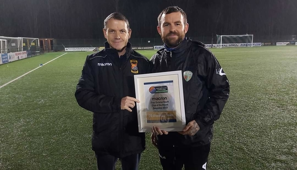 Nathan Leonard (right) receiving an award on behalf of FC Oswestry Town last season. Picture by NWCFL website