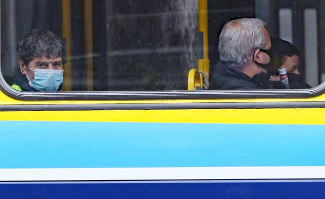 Bus passengers wearing face coverings. Image: PA