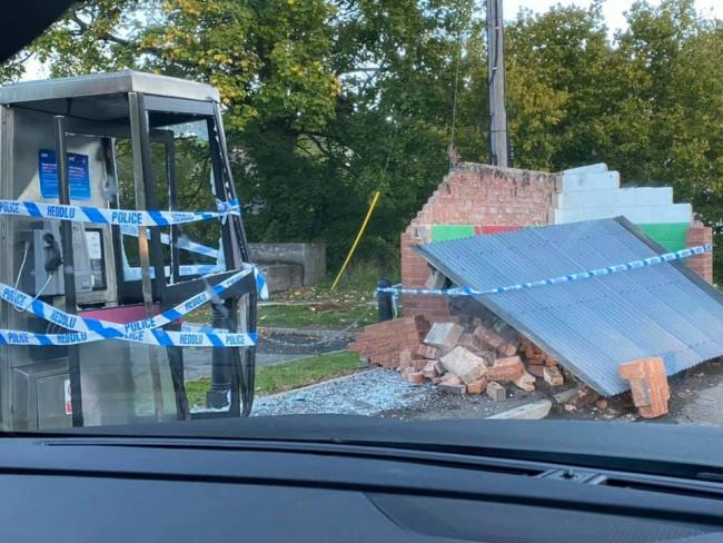 Destroyed phone box and bus stop in Bettws Cedewain.