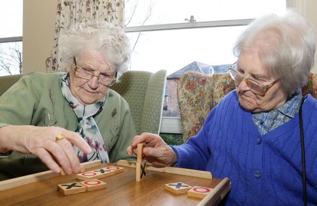 PB027-2018-7.The Ann Holloway Day Centre, Welshpool Feature..pictured playing naughts and crosses are l-r Doreen Jones and Jane Gwalchmai.Picture by Phil Blagg.PB027-2018-7.