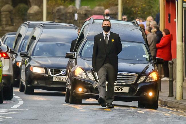 Three hearses process through the main road in Pentre during the funeral of Gladys, Dean and Darren Lewis at St Peter's Church in Pentre, South Wales. Mrs Lewis and her two sons all died of Covid-19 within five days of each other. PA Photo. Picture da