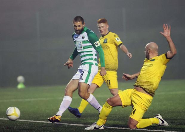 County Times: Greg Draper in action against Aberystwyth Town. Picture by Brian Jones
