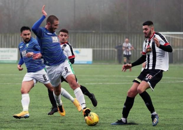 County Times: Greg Draper in action against Cefn Druids last season. Picture by Brian Jones