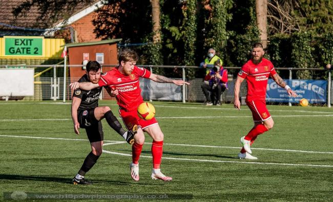Jack Kelly in action for Newtown against Connah's Quay Nomands. Picture by H18-PDW Photography.