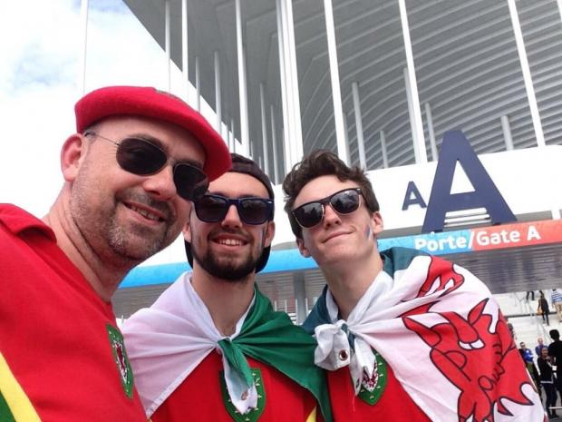 County Times: Left to right: Dad Gareth Owens, Ifan Owens and brother Tomi Owens at the Euro 2016 in Bordeaux. Picture provided by family