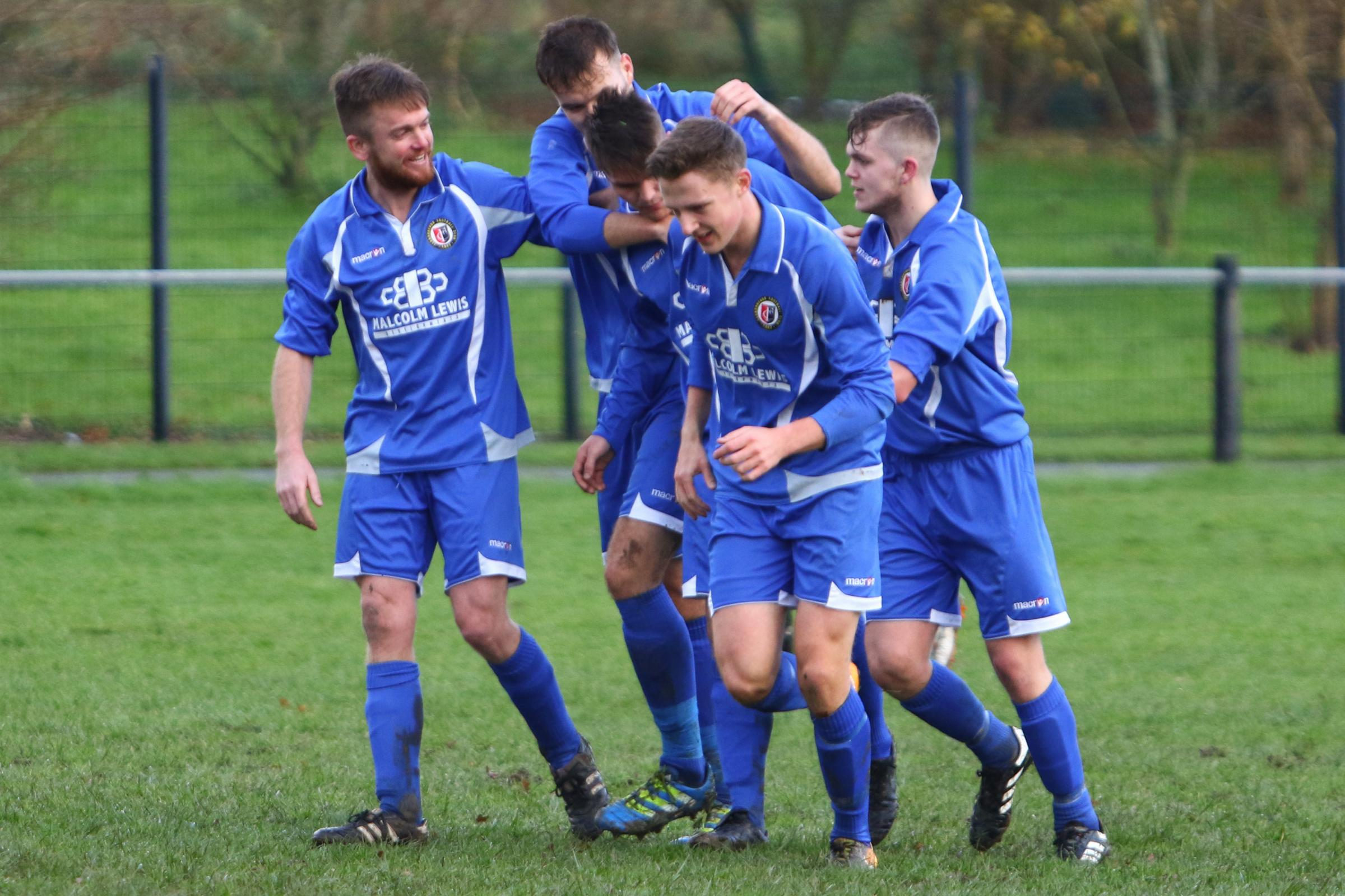 Goal. Iwan Matthews is congratulated after scoring to make it 1-1 during the JD Welsh Cup fixture between Llanrhaeadr and Cefn Druids at Recreation Field, Llanrhaeadr Ym Mochnant. Picture: Mike Sheridan (MS817-2017)