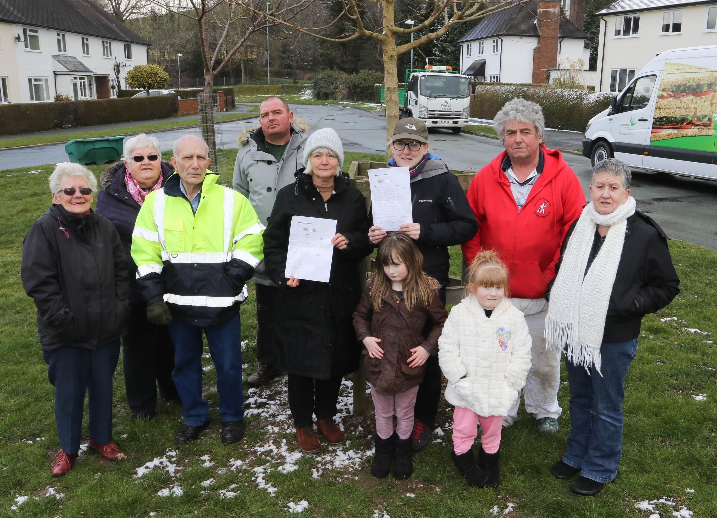 PB117-2018-4.Roundabout cylcle lane protestors, Garthowen Estate Newtown.pictured are local residents with fron centre left to right, Cllr Susan Hill and Kelly Leah (organiser) with the petition.Picture by Phil Blagg.PB117-2018-4.