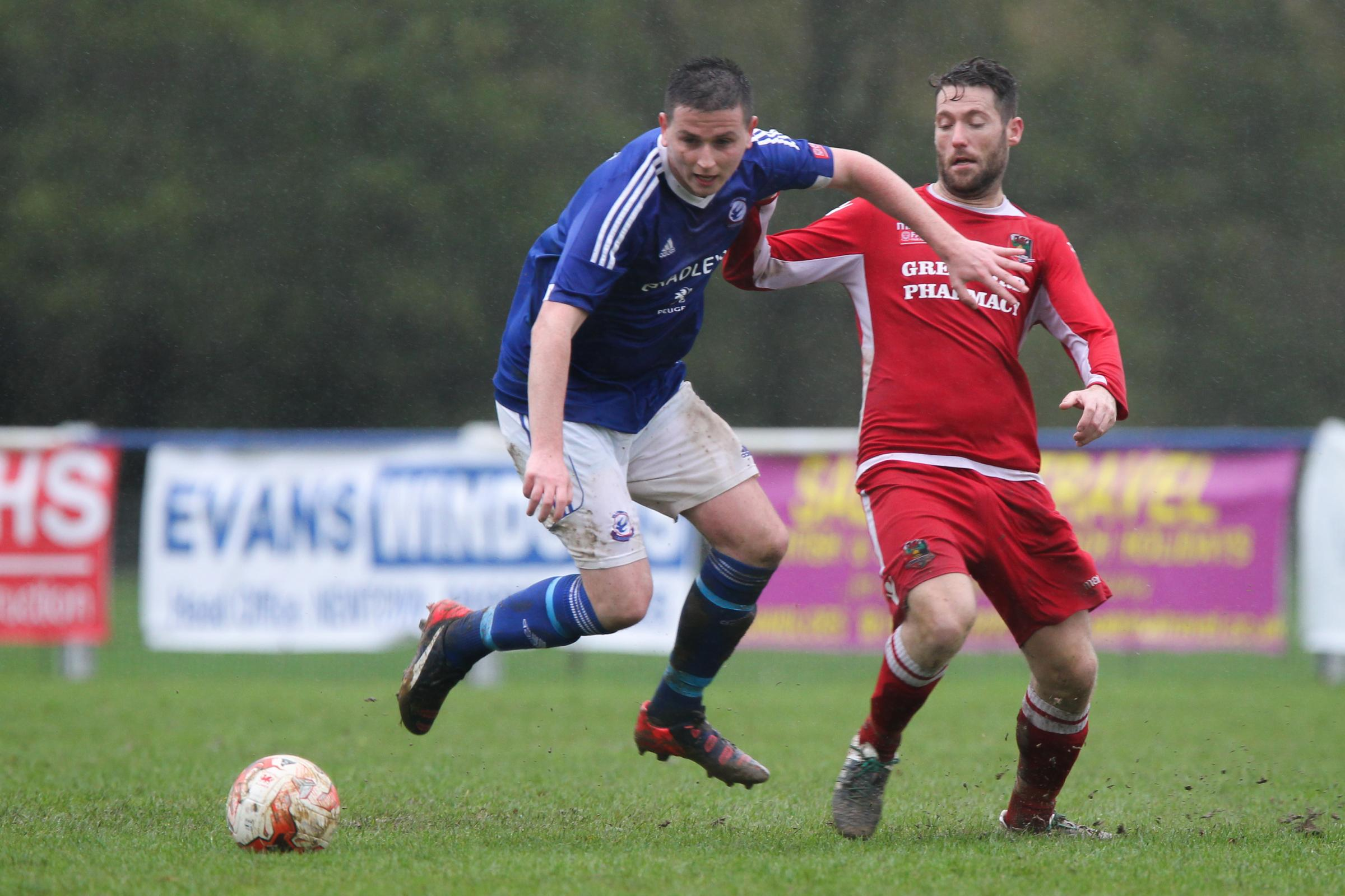 Rhydian Davies battles for the ball during the Huws Gray League Cup match between Caersws FC and Gresford Athletic at the Recreation ground on Saturday, October 21, 2017.Pic: Mike Sheridan/County TimesMS754-2017