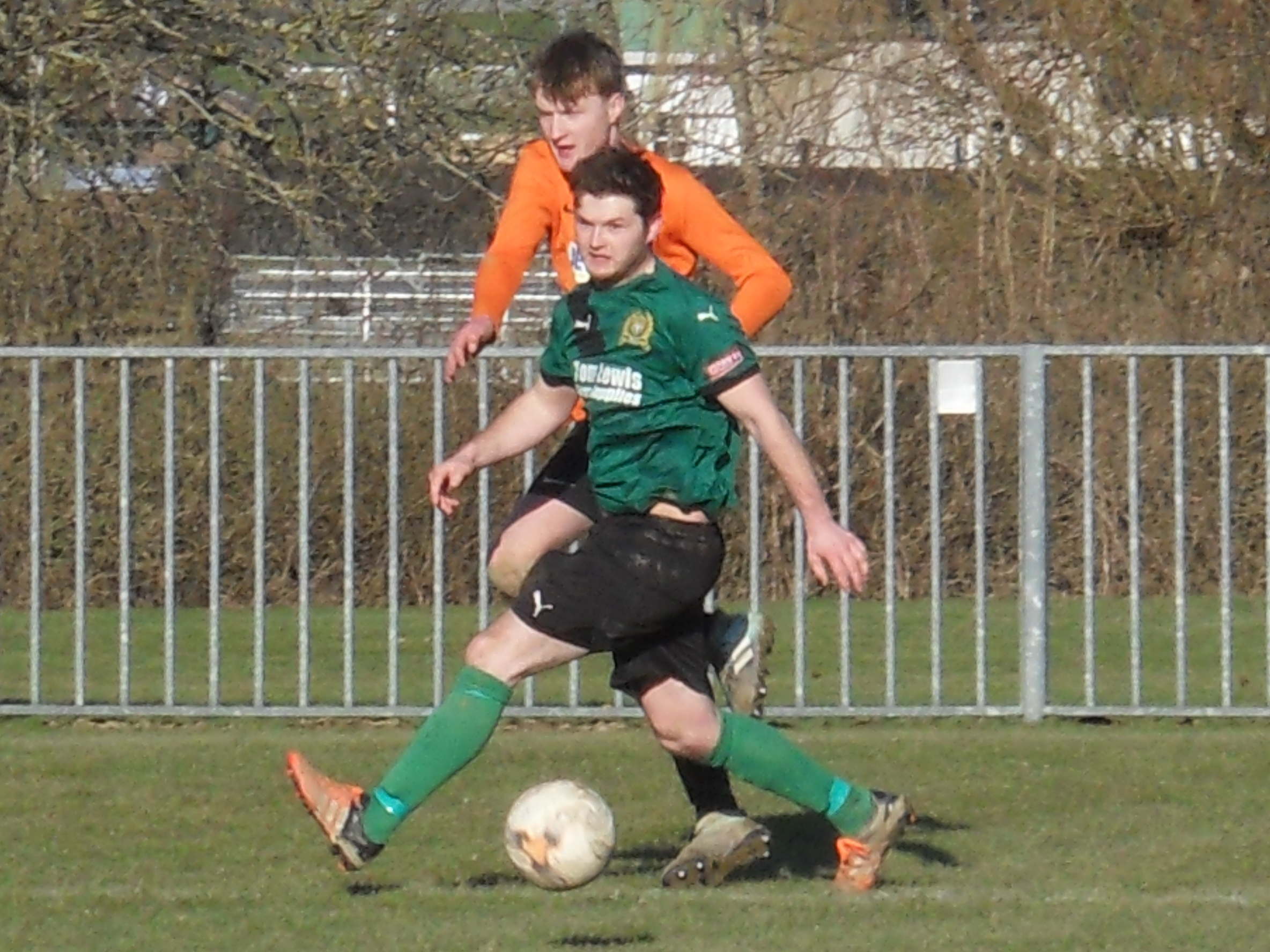 Radnor Valley's Callum Matthews in action with Ryan Powell of Builth Wells. Picture by Stuart Townsend.