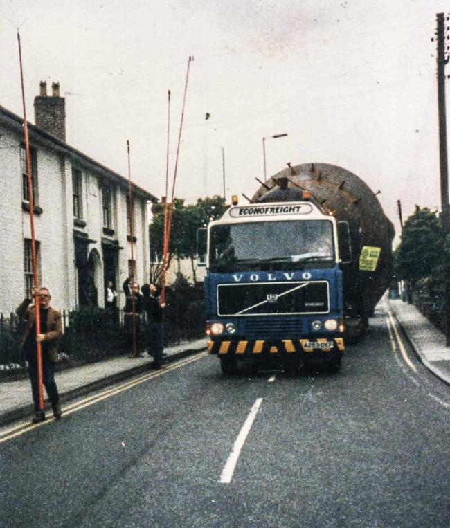 This week's Memory Lane photo is a bit of a mystery.The photo shows an Econofreight specialist heavy haulage lorry, with a 1983 registration, making its way through Welshpool.We're not sure what the strange load is or where it was heading – can any