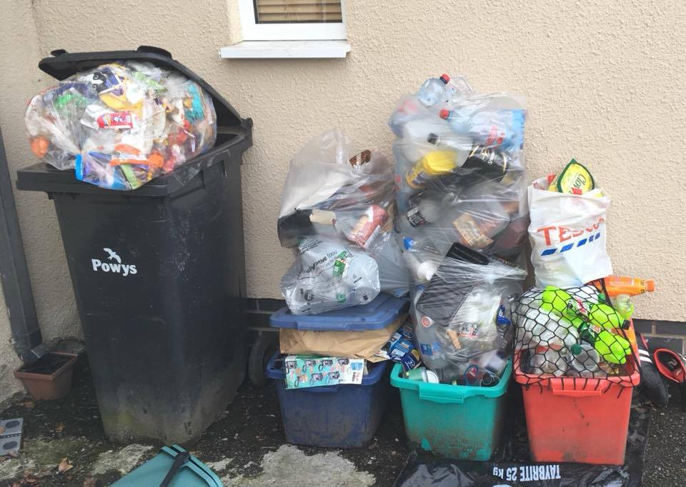 Residents at Derwenlas near Machynlleth had to wait weeks for their rubbish to be collected.