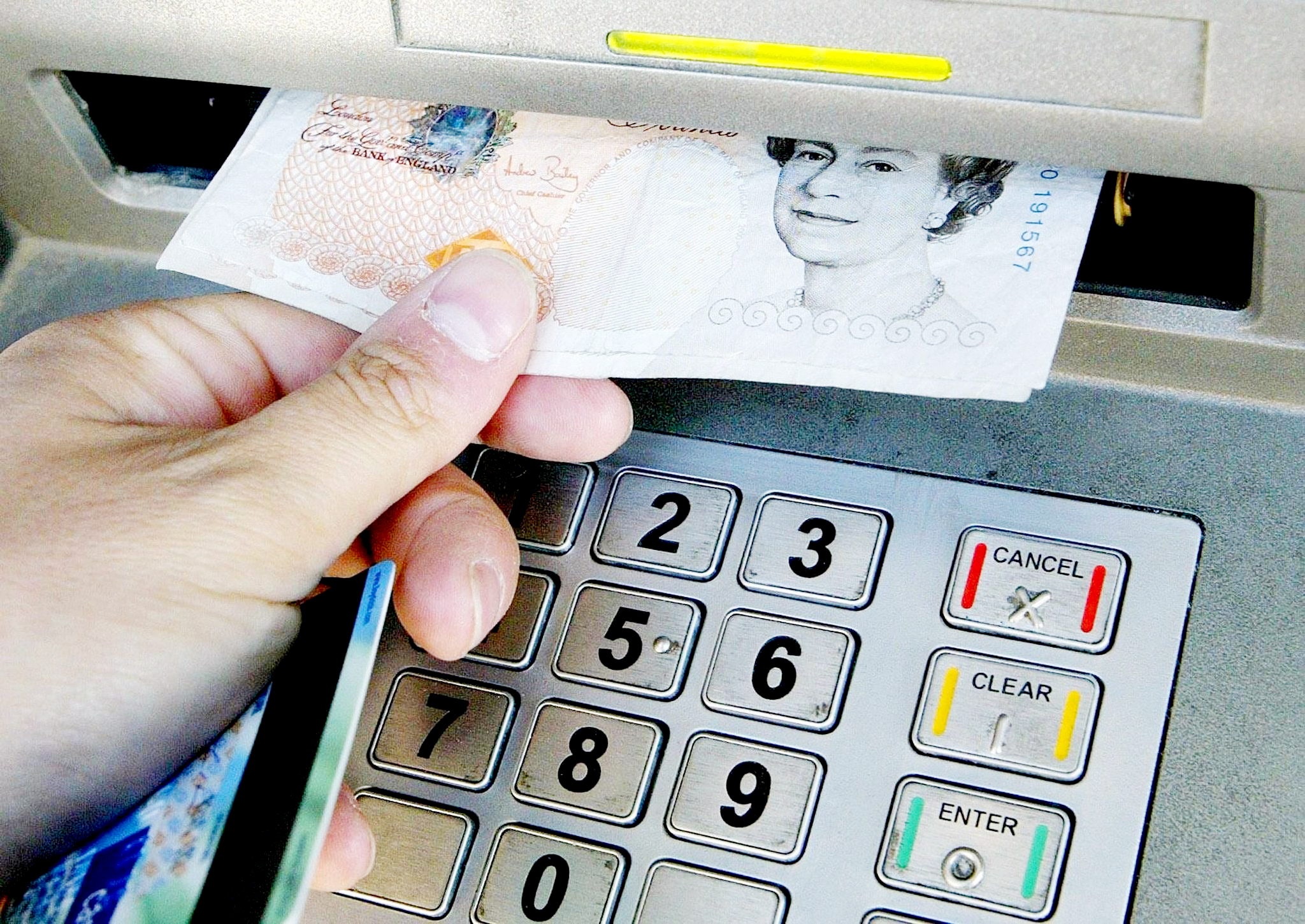A person withdrawing money from a cashpoint
