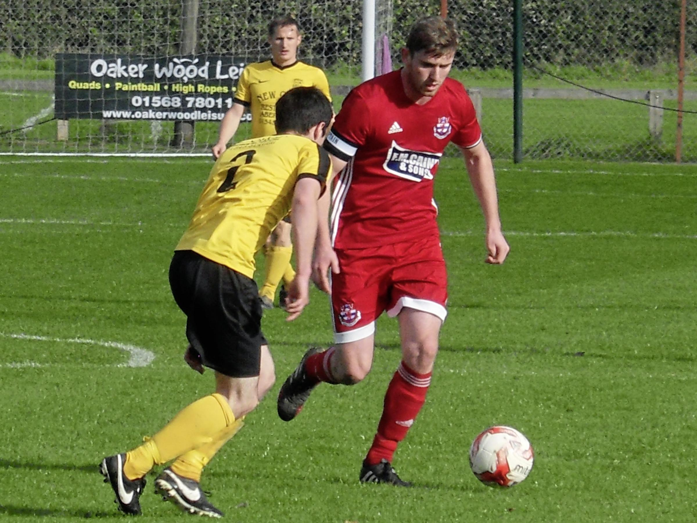 Knighton Town's Adam Farmer broke his tibia at Llanfair on Saturday.