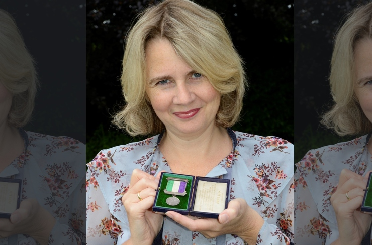 Auctioneer Catherine Southon with one of the Suffragette medals which sold for £50,000