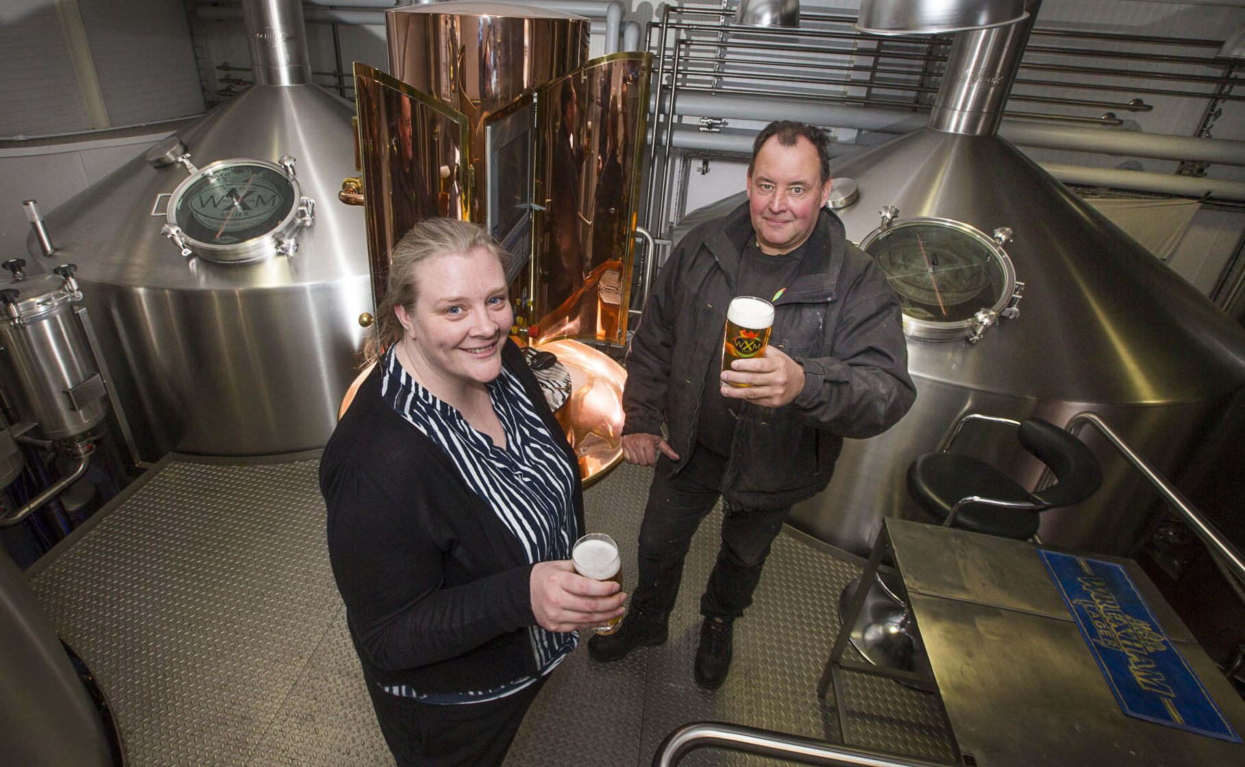 Managing director Mark Roberts with Donna Hughes, of Wrexham Northern Marches, at the Wrexham Lager brewery in Wrexham.