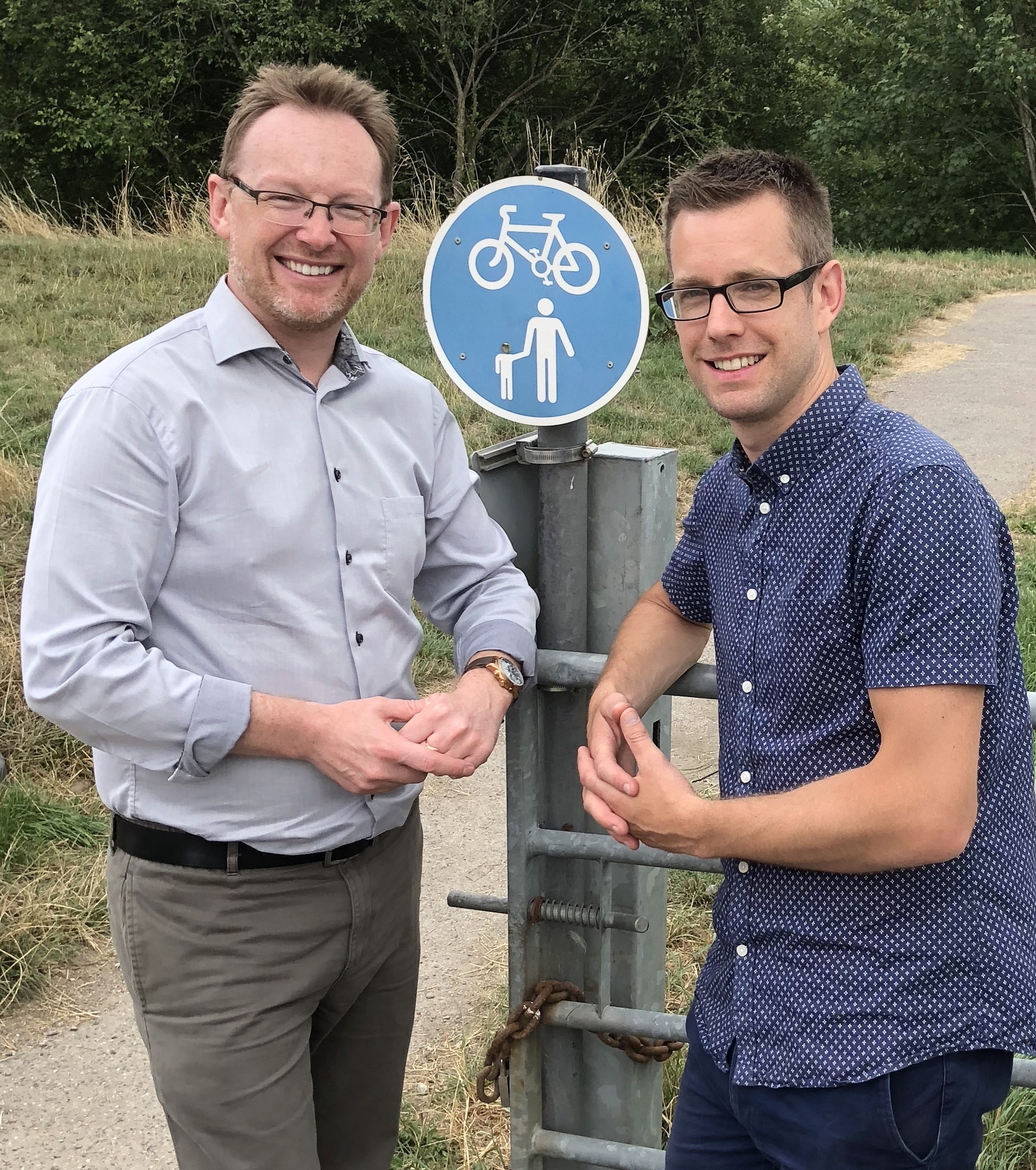Russell George AM and Cllr. Daniel Rowlands at the location of the new bridge in Newtown just off Canal Road.