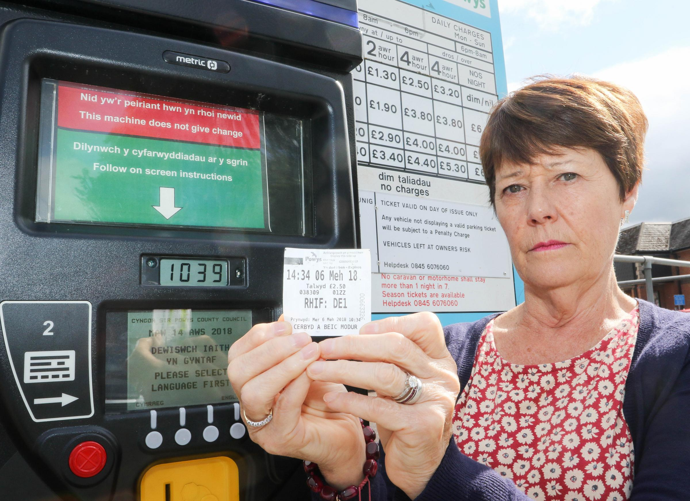 Jeanette Shearer from Newtown with her car park ticket fine at Berriew Street Car Park, Welshpool..Picture by Phil Blagg..PB407-2018-7.